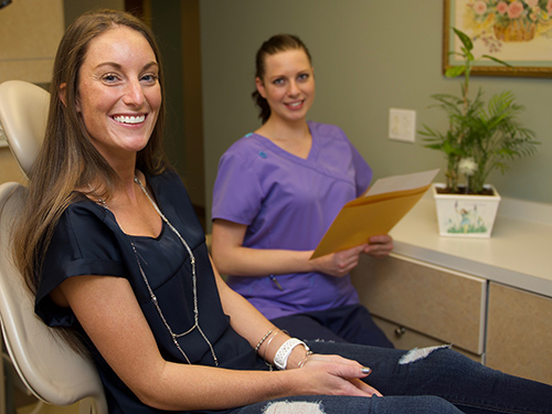 woman smiles in Stow-Munroe Falls cosmetic dentistry office Munroe Falls Family Dentistry